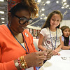 Tenth Triennial Gathering | Kimberly Bryant, Indianapolis, Ind., St. Stevens, Chicago, teaches Samara Marquez, 9, Beloit, Wisc., beading in the girls space.