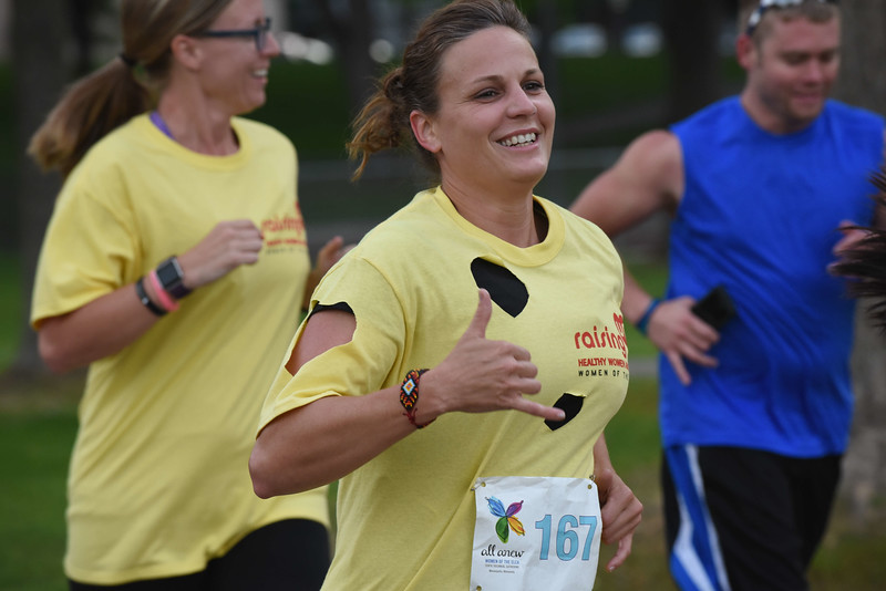 Tenth Triennial Gathering   Sara Larson, Balaton, Minn., gestures that all is good at the Run, Walk and Roll.