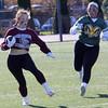 Lynn, Ma. 11-19-17. Sydney Denham, of Lynn English High School, sidesteps a Lynn Classical High School opponent during the powder puff game at Manning Field on Sunday.