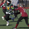 Lynn, Ma. 11-19-17. Rhode Alcindor of Lynn Classical High, plows past a player from Lynn English High in the powder puff game at Manning Field on Sunday.