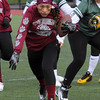 Lynn, Ma. 11-19-17. Adriana Chhor pushes her way past opponents from Lynn Classical High during the Powder Puff game played at Manning Field on Sunday.