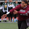 Lynn, Ma. 11-19-17. Liana Funicella hands the ball to a team mate during the powder puff game at Manning Field on Sunday.