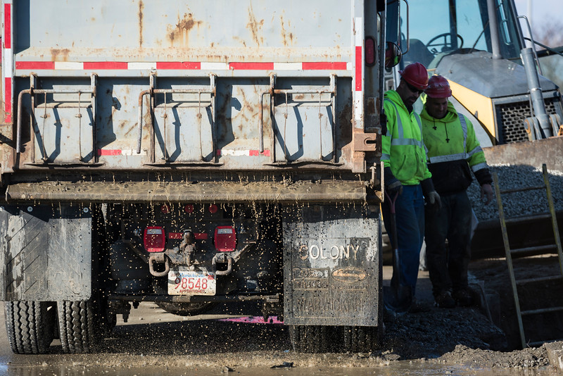 Water drips from a dump truck as a crew from N. Granese & Sons General Contractors works to repair a water main break in front of the Life Saving Station in Nahant on Wednesday.