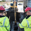 A crew from N. Granese & Sons General Contractors works to repair a water main break in front of the Life Saving Station in Nahant on Wednesday.