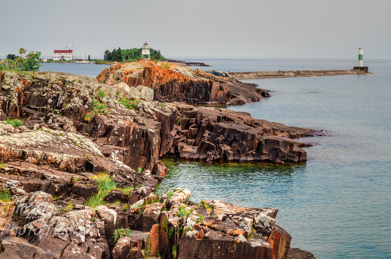Grand Marais Harbor is protected by Artist's Point, a barrier island formed by lava that was connected to the mainland by gravel deposited by lake currents, forming a tombolo. An Arctic–alpine disjunct community survives there