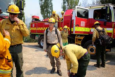 Firefighters from a joint Australian and U.S. strike team have a briefing as they work to bring a bushfire under control to protect nearby structures, in Alpine National Park near Omeo, Victoria, Australia, January 12, 2020. The Australian firefighters are with Country Fire Authority Australia and the U.S. team is the third rotation in for 28 days and they come from five different U.S. agencies, the U.S. Forest Service, U.S. Fish and Wildlife, Bureau of Land Management, Bureau of Indian Affairs and the National Park Services.