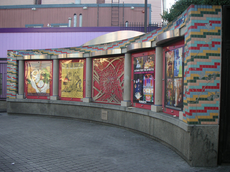 "This outdoor gallery serves as both a community bulletin board and exhibit space for local artists. The exhibits change bi-monthly.  The 16th Street BART station was once a bleak, uninviting, and unsafe transportation hub of San Francisco's Mission District, but a 7-year planning process, community and public agency support, and TE funds transformed the station into the vibrant public plaza and community meeting place it is today. The groups participating in the planning process include BART, the Metropolitan Transportation Commission, the San Francisco County Transportation Authority, Mission Housing Development Corporation, Urban Ecology, and the Mission Community Council.   Today, the 16th Street BART Station Plaza is the realized vision of the community. Vibrant mosaics, sitting steps, colorful, artistic gates, benches, and the <a href=""http://www.micocosf.org/plaza16.php"">Plaza 16 Project</a>, an outdoor gallery in the plaza that displays work by local artists, makes the station a welcoming place to rendezvous with a friend or make a transit connection.   Two TE grants, in 2002 and 2005, amounting to a total of $2,996,000 leveraged $428,000 in local support."