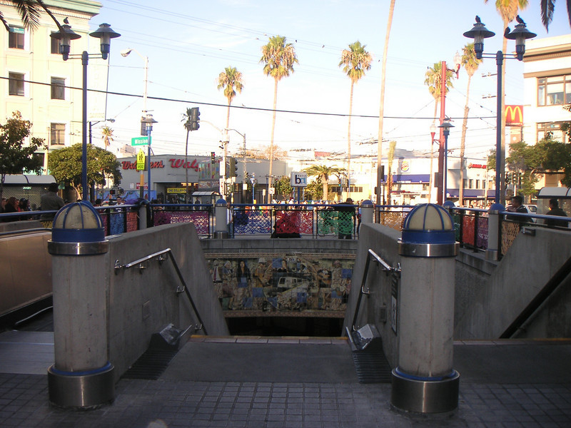 """The 16th Street BART station was once a bleak, uninviting, and unsafe transportation hub of San Francisco's Mission District, but a 7-year planning process, community and public agency support, and TE funds transformed the station into the vibrant public plaza and community meeting place it is today. The groups participating in the planning process include BART, the Metropolitan Transportation Commission, the San Francisco County Transportation Authority, Mission Housing Development Corporation, Urban Ecology, and the Mission Community Council.   Today, the 16th Street BART Station Plaza is the realized vision of the community. Vibrant mosaics, sitting steps, colorful, artistic gates, benches, and the <a href=""""http://www.micocosf.org/plaza16.php"""">Plaza 16 Project</a>, an outdoor gallery in the plaza that displays work by local artists, makes the station a welcoming place to rendezvous with a friend or make a transit connection.   Two TE grants, in 2002 and 2005, amounting to a total of $2,996,000 leveraged $428,000 in local support."""
