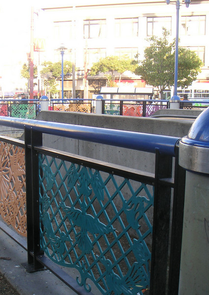 "These decorative gates replaced tall metal gates that detracted from the pedestrian environment.   The 16th Street BART station was once a bleak, uninviting, and unsafe transportation hub of San Francisco's Mission District, but a 7-year planning process, community and public agency support, and TE funds transformed the station into the vibrant public plaza and community meeting place it is today. The groups participating in the planning process include BART, the Metropolitan Transportation Commission, the San Francisco County Transportation Authority, Mission Housing Development Corporation, Urban Ecology, and the Mission Community Council.   Today, the 16th Street BART Station Plaza is the realized vision of the community. Vibrant mosaics, sitting steps, colorful, artistic gates, benches, and the <a href=""http://www.micocosf.org/plaza16.php"">Plaza 16 Project</a>, an outdoor gallery in the plaza that displays work by local artists, makes the station a welcoming place to rendezvous with a friend or make a transit connection.   Two TE grants, in 2002 and 2005, amounting to a total of $2,996,000 leveraged $428,000 in local support."