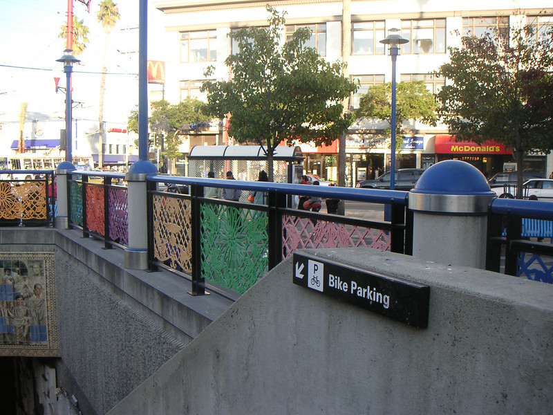 "During the station redesign, underground bike parking was installed at the station along with a wheel ramp for easy access.  The 16th Street BART station was once a bleak, uninviting, and unsafe transportation hub of San Francisco's Mission District, but a 7-year planning process, community and public agency support, and TE funds transformed the station into the vibrant public plaza and community meeting place it is today. The groups participating in the planning process include BART, the Metropolitan Transportation Commission, the San Francisco County Transportation Authority, Mission Housing Development Corporation, Urban Ecology, and the Mission Community Council.   Today, the 16th Street BART Station Plaza is the realized vision of the community. Vibrant mosaics, sitting steps, colorful, artistic gates, benches, and the <a href=""http://www.micocosf.org/plaza16.php"">Plaza 16 Project</a>, an outdoor gallery in the plaza that displays work by local artists, makes the station a welcoming place to rendezvous with a friend or make a transit connection.   Two TE grants, in 2002 and 2005, amounting to a total of $2,996,000 leveraged $428,000 in local support."