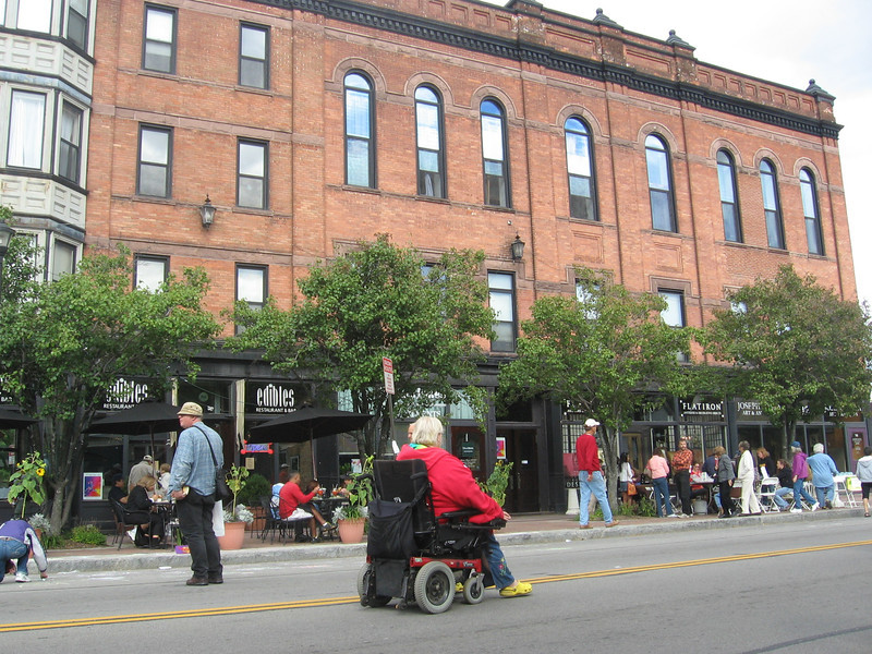 "Photo Credit: Evan Lowenstein   <a href=""http://www.rochesterartwalk.org/""> ARTwalk</a> is a unique outdoor museum in Rochester, NY. ARTwalk is an urban art trail connecting museums, galleries, shops, and public spaces throughout the <a href=""http://www.rochesternota.org/""> Rochester Neighborhood of the Arts District</a>. The neighborhood features many great cultural amenities such as the <a href=""http://www.rmsc.org/StrasenburghPlanetarium/""> Strasenburgh Planetarium </a>, <a href=""htpp://www.rochesterhistory.org/""> Rochester Historical Society </a>, <a href=""http://www.mag.rochester.edu/""> Memorial Art Gallery </a>, <a href=""http://www.vsw.org/""> Visual Studies Workshop </a>, <a href=""http://www.sotarochester.org/""> School of the Arts </a>, <a href=""http://www.eastmanhouse.org/""> George Eastman House and the International Museum of Photography and Film </a>.   The idea for ARTwalk originated from citizens and community leaders in an effort to revitalize the area of Rochester along University Ave. When planning began to redesign University Ave. citizens expressed their desire to take advantage of the existing cultural attractions by connecting and enhancing them. The resulting ARTwalk is a place for neighbors and tourists to mingle among the public art.   ARTwalk includes public art and decorative sidewalks along the way. Some of the public art was funded with TE funds but other art has been funded through private donations, community efforts, or other funding sources. The project used $234,000 in Federal TE funds and $110,000 in local match funds. The total of $343,000 built benches, art, decorative sidewalks, and bus shelters.   A truly collaborative museum, ARTwalk does not own any of the right of way in which it functions so it must consult with city, county, and state officials in order to follow regulations. The museum believes the art should appeal to a broad range of people since it is in the right of way. When art pieces are planned, open calls for art are advertised in the community and a jury selects and commissions the work to be made. Another example of the collaborative nature of ARTwalk is the Light pole Artistic Mosaic Project (LAMP). The goal of this project was to decorate light poles along University Ave. with mosaic tiles which any member of the community could help place.  The success of ARTwalk was clear through the economic revitalization of the surrounding arts district. The project was so successful that an extension is now under construction. Construction of the ARTwalk extension began in the summer of 2011 and will be completed in summer of 2012 using $3.8 million in American Recovery and Reinvestment Act funds. The extension will include decorative sidewalks, art in the sidewalks, interactive plazas with private art, and many more amenities."