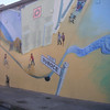 "What makes this bikeway so unique is the 6,000 square foot mural that runs the entire length of the back wall of the Safeway. Designed by Mona Caron and commissioned by the City of San Francisco Bike Program, the <a href=""http://www.monacaron.com/mural.html""> mural</a> received the Precita Eyes Best New Mural 1999 Award.   The Duboce Avenue Streetscape and Bikeway project is San Francisco's premiere car-free public space. Located in San Francisco's Castro District between Church and Market Street and adjacent to the J and N MUNI streetcar tracks, the project transformed a stark and run-down right-of-way behind a Safeway retail complex into a vibrant bikeway and pedestrian walkway. The bikeway connects cyclists traveling from downtown to what locals call, the Wiggle. As its name suggests, this bike route to Ocean Beach zigzags bicyclists around the grand hills of San Francisco allowing them to conserve energy and access the Pacific Ocean.   TE funding amounting to $410,000 was used to convert this portion of Duboce Avenue from motor vehicle to bicycle use. In addition, funds paid for landscaping and interpretive signage. The project received a local match of $250,000."