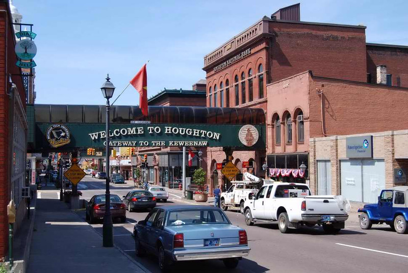 """The city of Houghton is located in north western Michigan and has a population of approximately 35,000 people. Located along Portage Lake, the city is full of history and recreational opportunities. In 2008, $1.15 million was obligated for a streetscaping project in downtown Houghton with a local match of $513,500. Houghton also worked with and a combination of traffic and safety, road preservation, and rural development funds to complete the project.  <br /> <br /> Us-41 is the main thoroughfare running through downtown Houghton with northbound traffic on Sheldon Avenue and southbound traffic on Montezuma Ave. The project included funds for historical streetlights, new sidewalks, and to replace asphalt with historical brick pavers. The main challenges to this project were the numerous businesses located on Sheldon Avenue and the cars that passed through. With the road construction season generally from May-October of each year, these businesses were very concerned that the project would have large impacts on their businesses. <br /> <br /> The initial concerns for businesses near the project were countered with the many effective actions taken by the local government and MDOT.  MDOT granted permission to the city to host events on sections of US-41 that were not under construction. These events included art festivals, concerts, and even a bmx biking event that utilized the extra dirt from the project. """"Construction cash,"""" a one dollar discount to downtown stores were distributed as a way to bring more people into downtown Houghton. These great ideas helped to support businesses that otherwise may have struggled during the construction and helped to rejuvenate US-41 and downtown Houghton."""