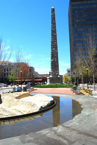 "The granite pillar, pictured here, is a focal point of Pack Square and serves as a beacon for Downtown Asheville and its historical links to the Civil War.  Pack Square Park in Asheville, North Carolina is said to be the realized dream of philanthropist George Willis Pack who donated the plot of land to the city in 1901. Nearly a century later, a water leak under Pack Square stimulated discussion to recreate and redesign Pack Square and City-County Plaza into a new public space, which has become the centerpiece of Downtown Asheville. The resulting 6.5 acre park, which sits in front of Buncombe County Courthouse and Asheville City Hall, is comprised of <a href =""http://www.packsquarepark.org/index.php?option=com_content&task=view&id=27&Itemid=41"""">Pack Square</a>, <a href=""http://www.packsquarepark.org/index.php?option=com_content&task=view&id=26&Itemid=40"""">Reuter Terrace</a>, and <a href= ""http://www.packsquarepark.org/index.php?option=com_content&task=view&id=25&Itemid=39"""">Roger McGuire Green</a>, which is the location of Bascom Lamar Lundsford Stage. The park opened on September 25, 2009.  A $140,000 Federal TE grant, procured in 2002, funded the development of the park and streetscaping around Pack Square, contiguous to three major streets: College Street, Patten Avenue, and Biltmore Avenue (US 25). In addition to the Federal funding, Pack Square Park was made possible with generous contributions by private donors."