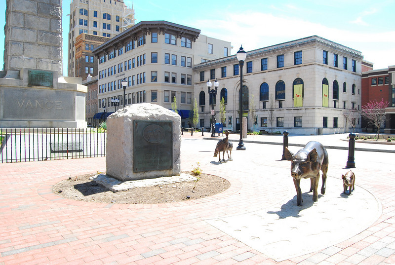 """These turkeys and pigs are stop number 2 on Asheville's <a href=""""http://www.romanticasheville.com/urban_trail.htm"""">Urban Trail</a>, a 1.7 mile walking tour of Downtown Asheville. Other stops include significant downtown architecture and outdoor sculptures by local artists.  Pack Square Park in Asheville, North Carolina is said to be the realized dream of philanthropist George Willis Pack who donated the plot of land to the city in 1901. Nearly a century later, a water leak under Pack Square stimulated discussion to recreate and redesign Pack Square and City-County Plaza into a new public space, which has become the centerpiece of Downtown Asheville. The resulting 6.5 acre park, which sits in front of Buncombe County Courthouse and Asheville City Hall, is comprised of <a href =""""http://www.packsquarepark.org/index.php?option=com_content&task=view&id=27&Itemid=41"""""""">Pack Square</a>, <a href=""""http://www.packsquarepark.org/index.php?option=com_content&task=view&id=26&Itemid=40"""""""">Reuter Terrace</a>, and <a href= """"http://www.packsquarepark.org/index.php?option=com_content&task=view&id=25&Itemid=39"""""""">Roger McGuire Green</a>, which is the location of Bascom Lamar Lundsford Stage. The park opened on September 25, 2009.  A $140,000 Federal TE grant, procured in 2002, funded the development of the park and streetscaping around Pack Square, contiguous to three major streets: College Street, Patten Avenue, and Biltmore Avenue (US 25). In addition to the Federal funding, Pack Square Park was made possible with generous contributions by private donors."""