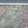 <b>Surviving original sidewalks, such as this herringbone brick patterned walkway, will be removed and reset in place with damaged areas replaced by new brick as part of the TE historic preservation project.</b>  The Stockton Street Historic District Streetscape project is the result of a community-driven and historically-focused economic stimulus plan. Even before the recession, Hightstown Borough struggled to keep its local economy afloat. Suburban development patterns made it difficult for locally-owned businesses downtown to survive. Its industry had shut its doors, and the housing crisis only added to the number of abandoned properties scarring the borough. With traditional mechanisms of economic stimulus limited, Hightstown developed a master plan that focused on re-establishing the borough as a destination town for visitors, similar to when it was a thriving railroad hub. Restoring the town's historic culture and marketing its small town pride is a central theme of the plan. The Stockton Street Historic District Streetscape project is a direct implementation strategy of this plan.   The Stockton Street Historic District is located in the Borough of Hightstown (pop. 5,216) in Mercer County, New Jersey. Seventy-six historic resources, predominantly single family dwellings, a stone church, and a historic monument contribute to this 14.35-acre district. These buildings are historically significant with varying architectural styles including early Federal, high-style Victorian, and turn-of-the-century eclectic.    The project, which is scheduled to begin construction in August 2010, seeks to restore the district's sidewalks to an eclectic mix of brick and slate. In addition, a granite curb will be constructed throughout the district to help define its boundaries by creating a consistent and distinctive look. Construction will be sensitive to unearthing carriage steps and resetting them in place along the street to convey the culture of yesteryear for visitors to the District.  The project assures handicapped accessibility throughout the public pathways, as well as street trees, gardens, and landscaping the public space consistent with plantings appropriate during the historic period of significance.  Finally, ARRA funds will support the restoration of the Civil War Monument Park, the focal point of the District. The project was awarded $1.69 million of the $19.75 million ARRA funding allocated to the State of New Jersey. This represents the third largest award in the state.