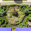 <b>This TE project restores the public pathways through the Historic District that lead to views of front gardens such as this formal boxwood maze garden that anchors a Queen Anne residence's fanciful exterior façade behind a historic wrought iron fence. The larger gardens behind the home continue their evolution from the original surviving Victorian-era boxwoods.</b>  The Stockton Street Historic District Streetscape project is the result of a community-driven and historically-focused economic stimulus plan. Even before the recession, Hightstown Borough struggled to keep its local economy afloat. Suburban development patterns made it difficult for locally-owned businesses downtown to survive. Its industry had shut its doors, and the housing crisis only added to the number of abandoned properties scarring the borough. With traditional mechanisms of economic stimulus limited, Hightstown developed a master plan that focused on re-establishing the borough as a destination town for visitors, similar to when it was a thriving railroad hub. Restoring the town's historic culture and marketing its small town pride is a central theme of the plan. The Stockton Street Historic District Streetscape project is a direct implementation strategy of this plan.   The Stockton Street Historic District is located in the Borough of Hightstown (pop. 5,216) in Mercer County, New Jersey. Seventy-six historic resources, predominantly single family dwellings, a stone church, and a historic monument contribute to this 14.35-acre district. These buildings are historically significant with varying architectural styles including early Federal, high-style Victorian, and turn-of-the-century eclectic.    The project, which is scheduled to begin construction in August 2010, seeks to restore the district's sidewalks to an eclectic mix of brick and slate. In addition, a granite curb will be constructed throughout the district to help define its boundaries by creating a consistent and distinctive look. Construction will be sensitive to unearthing carriage steps and resetting them in place along the street to convey the culture of yesteryear for visitors to the District.  The project assures handicapped accessibility throughout the public pathways, as well as street trees, gardens, and landscaping the public space consistent with plantings appropriate during the historic period of significance.  Finally, ARRA funds will support the restoration of the Civil War Monument Park, the focal point of the District. The project was awarded $1.69 million of the $19.75 million ARRA funding allocated to the State of New Jersey. This represents the third largest award in the state.