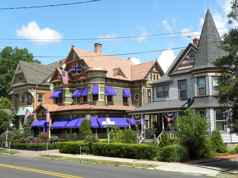 <b>Three painted ladies convey the artful essence of Hightstown's historic district, reflecting the ornament of eclectic Victorian architecture.  The Queen Anne residence in the center, was built by the town's undertaker, Elmer Rogers, and given to his bride as a wedding present in 1892.  Though it underwent many transitions over the past 120 years, including subdivision into apartments, the grand home has been extensively restored over the last decade, and remains now a single-family home as a key contributing resource in the Historic District.  The interior boasts original geometric patterned oak floors, chestnut pocket doors and moldings gracing Victorian furnished parlors and a formal music room with grand player piano adjacent to the chestnut paneled dual landing staircase.  Silk portieres, domed ceilings, and original stained glass designed to complement the Rogers family crest adorning the main fireplace surround are just a few of the details that convey the original owners enjoyment of Victorian expression in architecture. </b>  The Stockton Street Historic District Streetscape project is the result of a community-driven and historically-focused economic stimulus plan. Even before the recession, Hightstown Borough struggled to keep its local economy afloat. Suburban development patterns made it difficult for locally-owned businesses downtown to survive. Its industry had shut its doors, and the housing crisis only added to the number of abandoned properties scarring the borough. With traditional mechanisms of economic stimulus limited, Hightstown developed a master plan that focused on re-establishing the borough as a destination town for visitors, similar to when it was a thriving railroad hub. Restoring the town's historic culture and marketing its small town pride is a central theme of the plan. The Stockton Street Historic District Streetscape project is a direct implementation strategy of this plan.   The Stockton Street Historic District is located in the Borough of Hightstown (pop. 5,216) in Mercer County, New Jersey. Seventy-six historic resources, predominantly single family dwellings, a stone church, and a historic monument contribute to this 14.35-acre district. These buildings are historically significant with varying architectural styles including early Federal, high-style Victorian, and turn-of-the-century eclectic.    The project, which is scheduled to begin construction in August 2010, seeks to restore the district's sidewalks to an eclectic mix of brick and slate. In addition, a granite curb will be constructed throughout the district to help define its boundaries by creating a consistent and distinctive look. Construction will be sensitive to unearthing carriage steps and resetting them in place along the street to convey the culture of yesteryear for visitors to the District.  The project assures handicapped accessibility throughout the public pathways, as well as street trees, gardens, and landscaping the public space consistent with plantings appropriate during the historic period of significance.  Finally, ARRA funds will support the restoration of the Civil War Monument Park, the focal point of the District. The project was awarded $1.69 million of the $19.75 million ARRA funding allocated to the State of New Jersey. This represents the third largest award in the state.