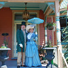 <b>During the  <i>Spring on the Veranda</i>, residents dress in period clothing and welcome visitors to the district.</b>  The Stockton Street Historic District Streetscape project is the result of a community-driven and historically-focused economic stimulus plan. Even before the recession, Hightstown Borough struggled to keep its local economy afloat. Suburban development patterns made it difficult for locally-owned businesses downtown to survive. Its industry had shut its doors, and the housing crisis only added to the number of abandoned properties scarring the borough. With traditional mechanisms of economic stimulus limited, Hightstown developed a master plan that focused on re-establishing the borough as a destination town for visitors, similar to when it was a thriving railroad hub. Restoring the town's historic culture and marketing its small town pride is a central theme of the plan. The Stockton Street Historic District Streetscape project is a direct implementation strategy of this plan.   The Stockton Street Historic District is located in the Borough of Hightstown (pop. 5,216) in Mercer County, New Jersey. Seventy-six historic resources, predominantly single family dwellings, a stone church, and a historic monument contribute to this 14.35-acre district. These buildings are historically significant with varying architectural styles including early Federal, high-style Victorian, and turn-of-the-century eclectic.    The project, which is scheduled to begin construction in August 2010, seeks to restore the district's sidewalks to an eclectic mix of brick and slate. In addition, a granite curb will be constructed throughout the district to help define its boundaries by creating a consistent and distinctive look. Construction will be sensitive to unearthing carriage steps and resetting them in place along the street to convey the culture of yesteryear for visitors to the District.  The project assures handicapped accessibility throughout the public pathways, as well as street trees, gardens, and landscaping the public space consistent with plantings appropriate during the historic period of significance.  Finally, ARRA funds will support the restoration of the Civil War Monument Park, the focal point of the District. The project was awarded $1.69 million of the $19.75 million ARRA funding allocated to the State of New Jersey. This represents the third largest award in the state.