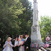 <b>During the <i>Spring on the Veranda</i>, a Civil War historian discusses the local impact of the war with visitors at the Civil War memorial erected in 1875.</b>  The Stockton Street Historic District Streetscape project is the result of a community-driven and historically-focused economic stimulus plan. Even before the recession, Hightstown Borough struggled to keep its local economy afloat. Suburban development patterns made it difficult for locally-owned businesses downtown to survive. Its industry had shut its doors, and the housing crisis only added to the number of abandoned properties scarring the borough. With traditional mechanisms of economic stimulus limited, Hightstown developed a master plan that focused on re-establishing the borough as a destination town for visitors, similar to when it was a thriving railroad hub. Restoring the town's historic culture and marketing its small town pride is a central theme of the plan. The Stockton Street Historic District Streetscape project is a direct implementation strategy of this plan.   The Stockton Street Historic District is located in the Borough of Hightstown (pop. 5,216) in Mercer County, New Jersey. Seventy-six historic resources, predominantly single family dwellings, a stone church, and a historic monument contribute to this 14.35-acre district. These buildings are historically significant with varying architectural styles including early Federal, high-style Victorian, and turn-of-the-century eclectic.    The project, which is scheduled to begin construction in August 2010, seeks to restore the district's sidewalks to an eclectic mix of brick and slate. In addition, a granite curb will be constructed throughout the district to help define its boundaries by creating a consistent and distinctive look. Construction will be sensitive to unearthing carriage steps and resetting them in place along the street to convey the culture of yesteryear for visitors to the District.  The project assures handicapped accessibility throughout the public pathways, as well as street trees, gardens, and landscaping the public space consistent with plantings appropriate during the historic period of significance.  Finally, ARRA funds will support the restoration of the Civil War Monument Park, the focal point of the District. The project was awarded $1.69 million of the $19.75 million ARRA funding allocated to the State of New Jersey. This represents the third largest award in the state.