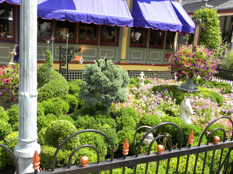 <b>Another view of the Queen Anne residence front gardens.</b>  The Stockton Street Historic District Streetscape project is the result of a community-driven and historically-focused economic stimulus plan. Even before the recession, Hightstown Borough struggled to keep its local economy afloat. Suburban development patterns made it difficult for locally-owned businesses downtown to survive. Its industry had shut its doors, and the housing crisis only added to the number of abandoned properties scarring the borough. With traditional mechanisms of economic stimulus limited, Hightstown developed a master plan that focused on re-establishing the borough as a destination town for visitors, similar to when it was a thriving railroad hub. Restoring the town's historic culture and marketing its small town pride is a central theme of the plan. The Stockton Street Historic District Streetscape project is a direct implementation strategy of this plan.   The Stockton Street Historic District is located in the Borough of Hightstown (pop. 5,216) in Mercer County, New Jersey. Seventy-six historic resources, predominantly single family dwellings, a stone church, and a historic monument contribute to this 14.35-acre district. These buildings are historically significant with varying architectural styles including early Federal, high-style Victorian, and turn-of-the-century eclectic.    The project, which is scheduled to begin construction in August 2010, seeks to restore the district's sidewalks to an eclectic mix of brick and slate. In addition, a granite curb will be constructed throughout the district to help define its boundaries by creating a consistent and distinctive look. Construction will be sensitive to unearthing carriage steps and resetting them in place along the street to convey the culture of yesteryear for visitors to the District.  The project assures handicapped accessibility throughout the public pathways, as well as street trees, gardens, and landscaping the pub