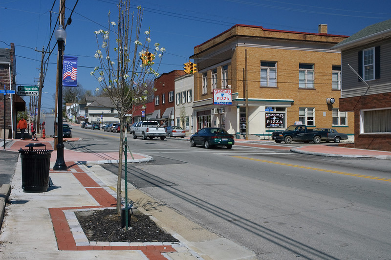"""The village of Williamsburg, Ohio received a category 5 Transportation Enhancements award in 2008 for $640,000 with an additional $160,000 in local match funds. The streetscaping effort took place in downtown Williamsburg on Main Street from Front St. to Broadway St. The design and engineering work was done by <a href= """"http://www.cds-assoc.com""""> CDS Associates<a/>        The project found many ways to make downtown Williamsburg more attractive and pedestrian friendly. New concrete sidewalks were installed with curb ramps, paver crosswalks, landscaped islands, and bump-outs near intersections. In addition to improvements to sidewalks and intersections, new trash cans, lighting fixtures, and benches were installed. All of these enhancements help to draw people downtown while making it safer for those already there."""