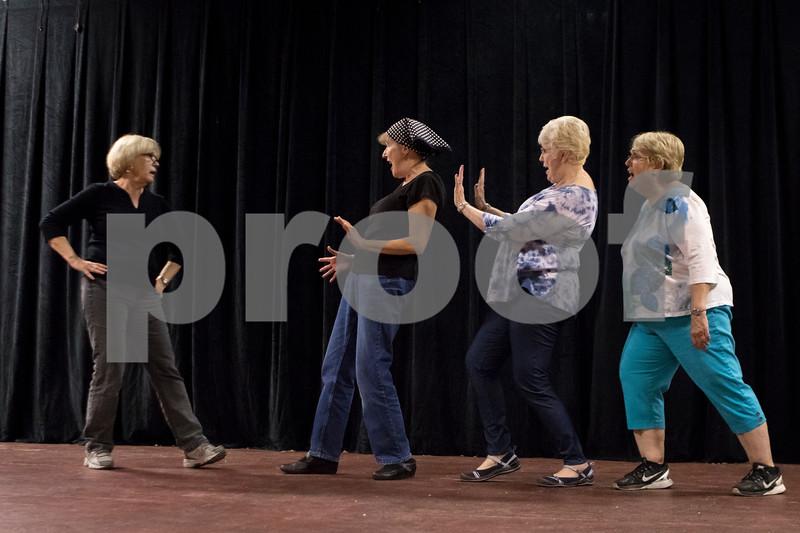 "Sam Buckner for Shaw Media.<br /> Chris Welsh (left), Deb Brubaker, Michele Patton and Paula Howlett sing ""Little Girls"" from Annie at rehersal on Tuesday November 1, 2016."