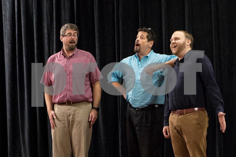 Sam Buckner for Shaw Media.<br /> Aaron Moorman (left), Gavin Wilson and Jeff Heider sing during rehersal on Tuesday Novemer 1, 2016.