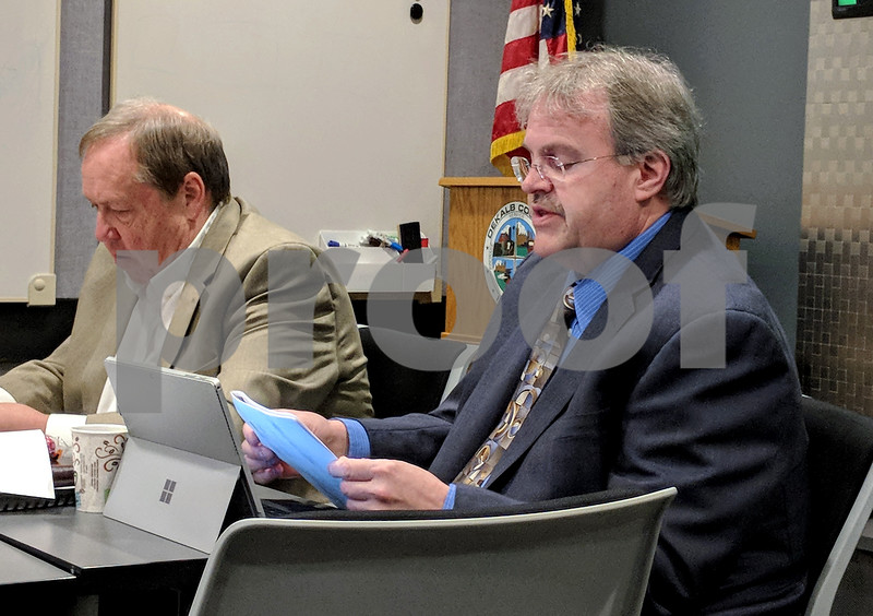County Administrator Gary Hanson (left) and Finance Director Peter Stefan were at the finance committee meeting Wednesday as it tries to finalize a budget.