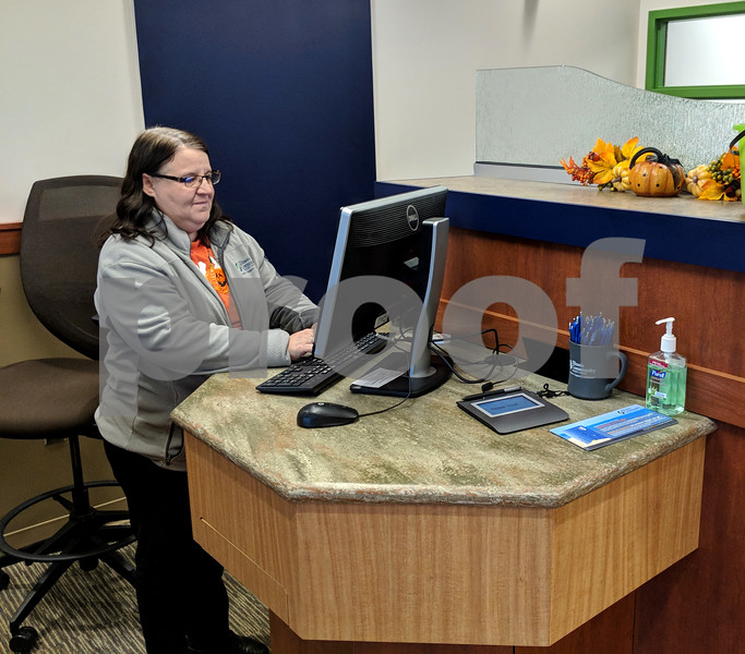Sandra Wilkins, a teller at Illinois Community Credit Union's Sycamore branch, is one of the employees using the new pods at the new building. The pods allow tellers to be more personal when working with members, rather than having a counter between them, CEO Thor Dolan said.