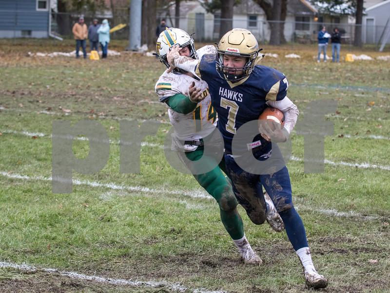 Sam Buckner for Shaw Media.<br /> Tyler Kilcullen stiff arms Lukas Tinkham of Abingdon High School on Saturday November 2, 2019.