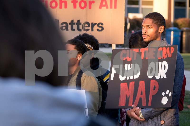 Sam Buckner for Shaw Media.<br /> Trauvell Crawford holds a sign at the NIU budget and MAP grant rally on Thursday November 3, 2016.