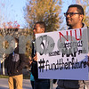 Sam Buckner for Shaw Media.<br /> Andrew Smith, student association senator, holds a sign in protest of Illinois not passing a state budget on Thursday November 3, 2016.
