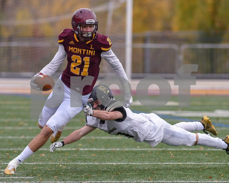 Montini wide receiver Nate Muersch (21) slips out of the grasp of Sycamore Defensive Back Kyle Antos (11) in the third quarter November 3rd in the second week of play offs.