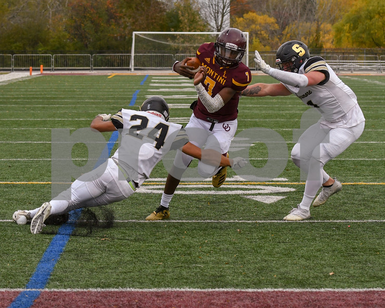 Montini Catholic Robert Brazziel (7) gains more than a first down yards and was a few yards shy of a touch down before being brought down by Sycamore Manuel Dominguez (24) and Sycamore Dylan Lozeau (1)