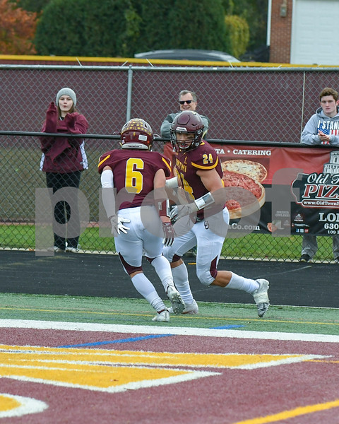 Montini Catholic Zack Olson (6) celebrates with teammate Nicholas Fedanzo (24) after Nicholas scored a touch down in the third quarter November 3rd during week two fo play offs.
