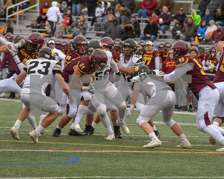 Montini running back Nick Fedanzo (24) gets through the first line of Sycamore defenders before being greeted by a few more defenders in the third quarter November 3rd in the week two of pay offs.