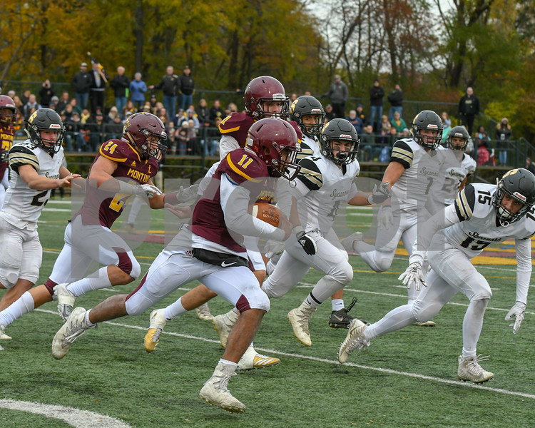 Montini Catholic Deontay Bell (11) runs for much need yards in the fourth quarter agents Sycamore in the second week of play offs on November 3rd.