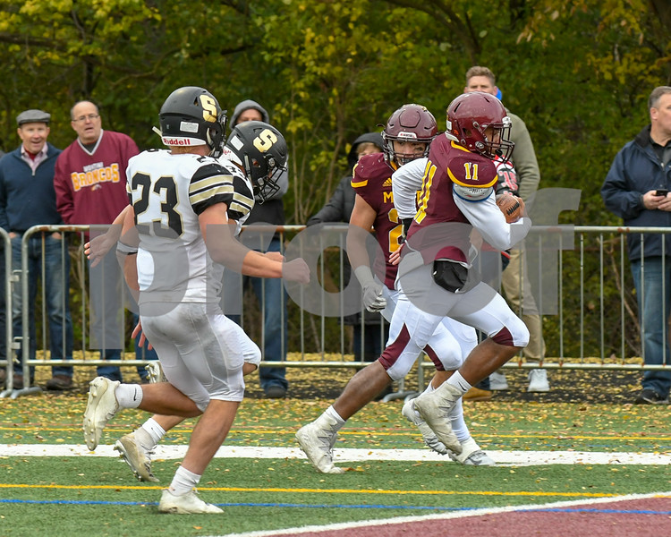 Montini Catholic Deontay Bell (11) runs the ball in for a touch down in the fourth quarter November 3rd agents Sycamore in the second round of playoffs.