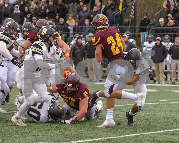 Sycamore Jason Hayes (12) takes down Montini Catholic Nicholas Fedanzo (24) in the fourth quarter of week two play offs.