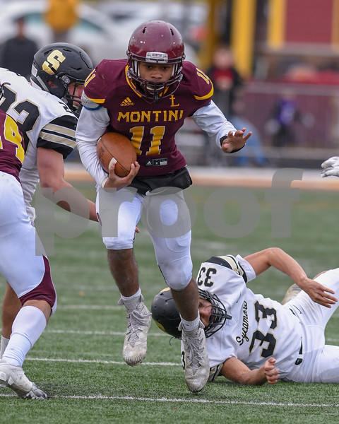 Montini Catholic Deontay Bell (11) gets past a Sycamore defender and runs the ball in the fourth quarter before being tackled during week two of play offs on Novembers 3rd.