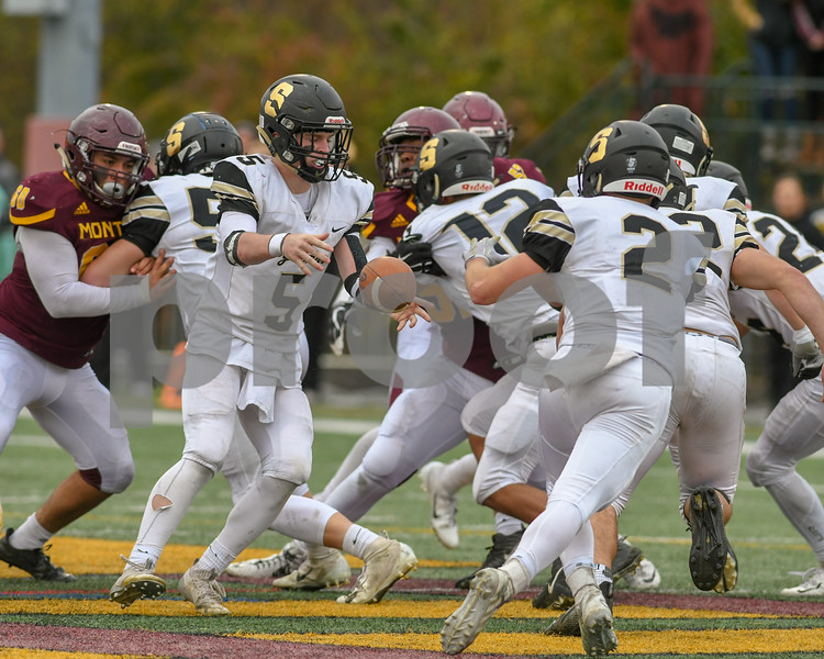 Sycamore Grant McConkey (5) tosses the ball to teammate Sycamore Connor Smith (2) in the fourth quarter before Conner was tackled shortly after for a small gain of yards on November 3rd in the second week of playoffs.