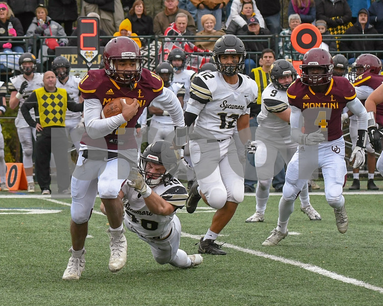 Sycamore Grayson Burns (40) tries to take down Montini Catholic Deontay Bell (11) but slips out his hands finds much need yards in the fourth quarter.