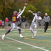 Montini Catholic Fred Stokes (32) breaks up the pass from Sycamore Grant McConkey (5) in the fourth quarter November 3rd during the second week of play offs