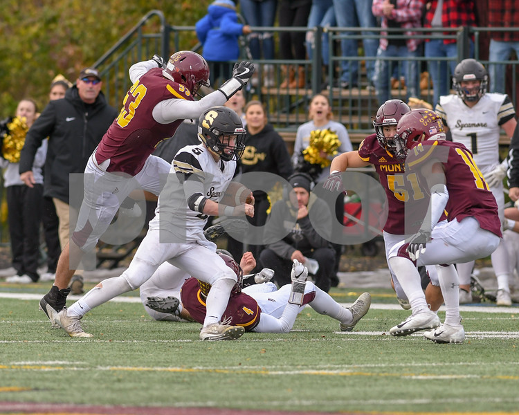 Sycamore Grant McConkey (5) tries to zig zag around Montini in the  third quarter before being wrapped up and brought down on November 3rd in the second week of pay offs.