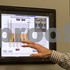 Sam Buckner for Shaw Media.<br /> Mark Eddington, Manager of the DeKalb Sanitation District, shows a system that can tell how all of the DeKalb Sanitation Districts facilities are functioning.