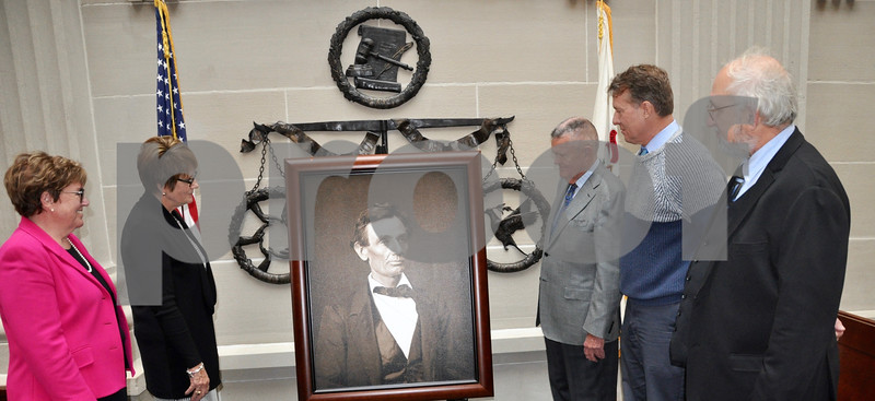 Photo by Barry Schrader for Shaw Media<br /> Admiring the donated portrait of Abraham Lincoln at the DeKalb County Courthouse presentation Thursday are, from left, County Circuit Clerk Maureen Josh, Chief Circuit Court Judge Robbin Stuckert, DeKalb attorney Ron Klein, Circuit Court Judge Brad Waller, and William Furry, executive director of the Illinois State Historical Society.
