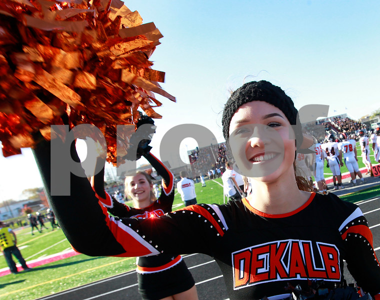 Candace H. Johnson – For Shaw Media<br /> DeKalb cheerleaders Lexi Clark, 16, and Adriana Ayala, 15, cheer for the varsity football team as they play Antioch in the third quarter at Antioch Community High School.