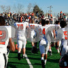 Candace H. Johnson – For Shaw Media<br /> DeKalb's varsity football team runs toward their fans after beating Antioch 36-3 in the 2nd round playoff game at Antioch Community High School.