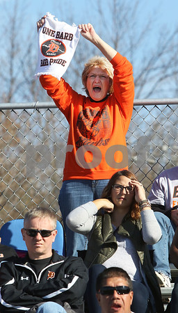 Candace H. Johnson – For Shaw Media<br /> Jackie Harvey, of Oswego cheers for the DeKalb football team and her grandson, (#37) Eric Letterer, as they play against Antioch in the third quarter of the 2nd round state playoff game at Antioch Community High School.